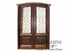 Intriciately detailed, this incredible antique door was completely crafted by hand and has been fully restored by our in house artisans; it will make any entrance truly grand. #antiquedoor #curbappeal #amighinidoors