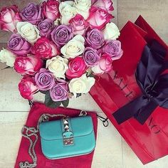 Roses and Valentino bag for the lady.