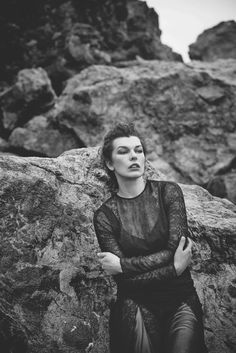 Milla Jovovich poses beachside in a sheer lace look for Harper's Bazaar Spain Magazine March 2016 Issue