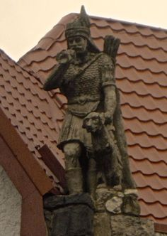 Vlad lll hunting statue on a church in Romania.