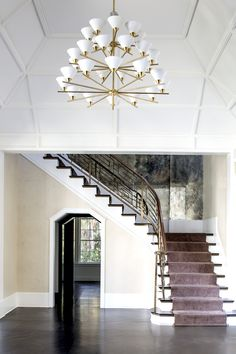 KELLY WEARSTLER | CLEO THREE-TIER CHANDELIER. Ideal for Dining Rooms, Living Rooms and spaces with high ceilings.