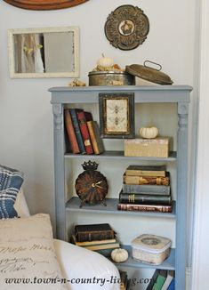 A recent bookcase makeover created a whole new look for a corner of my farmhouse family room. A two-tone paint application gives an easy custom look.