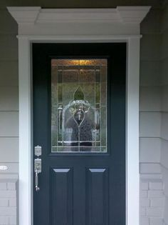 Love these color combinations. Gray exterior house, navy blue door, white trim
