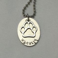 Custom stamped metal jewelry from Beckett Metal. $21. www.BeckettMetal.com. Honor your beloved pets, past and present, with this sturdy stainless steel necklace.