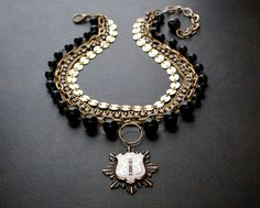 Chunky Assemblage Statement Necklace with Black Lucite, Layers of Gold Chain, Rhinestones and a Vintage Escutcheon Pendant