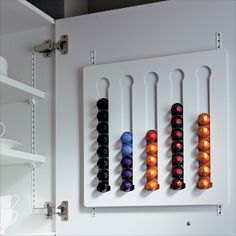 Néspresso capsule holder built into the cupboard. This is a good space saving alternative for small kitchens.