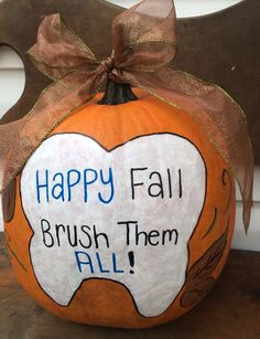 "Another cute ""brush them all"" pumpkin idea for dental office decor :)"