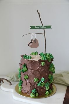 Little sloth cake with layers of chocolate sponge and caramel buttercream