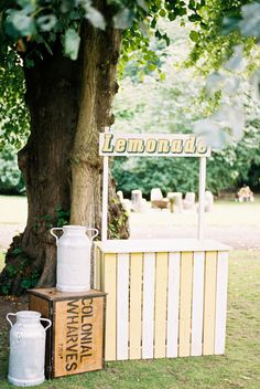 A gorgeous retro vibe to this lemonade stand makes a backyard party pop!