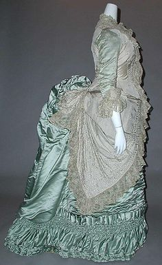 Sea green silk dress with ruched skirt and lace trim (side view), French, ca. 1880.