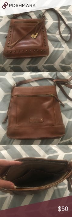 Cute Lucky Brand cross body purse 11x11x3. Lucky Brand cross body bag. Very cute. Pocket on front and back. Inner zipper pocket. EGUC. Ask with any questions. Offers welcome. Lucky Brand Bags Crossbody Bags