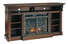 With its scrolled double doors in a rustic gunmetal-tone finish, Alymere TV stand brings a lovely mixed media effect to the big screen. Open-concept design gives the richly traditional styling a moder