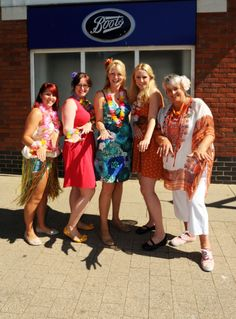 GARLANDS, grass skirts and beach wear replaced uniform for staff members at Ashbourne's Boots store.