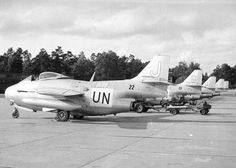 """Some SAAB J29 """"Tunnan"""" (The Barrel) from 22 U.N. Fighter Squadron, being readied for a mission in Kongo."""