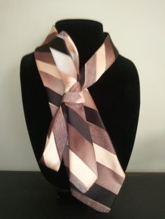 Brown Tie necklace. Snaps on and off, Its a fun way to dress for work or even everyday life.