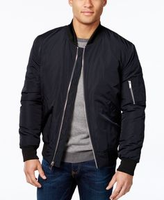 The lightweight feel of this Vince Camuto bomber jacket is complemented by the warm quilted interior. Plus, the extra zip pocket on the sleeve makes it distinctly fashion forward. | Shell: polyester;