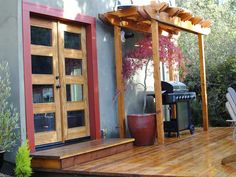 The beach is all about outdoor living, so Matt created a space that allows owners or renters to take advantage of the setting. A new redwood deck is nicely integrated with French doors, custom arbor and grill space. Outdoor Spaces, Outdoor Living, House Makeovers, Mid Century Exterior, Outdoor Projects, Outdoor Ideas, Diy Projects, San Diego Houses, Lakefront Homes