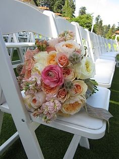 love these white chairs for a summer wedding outside