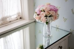 San Diego Wedding Flowers: Cute pastel bridal bouquet with light pink peonies, blush peach roses, and white stephanotis with white roses.