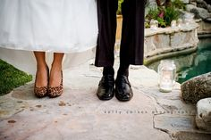 Kelly Colson Photography - Love the shot of their shoes especially when they are fun shoes!  In this case the groom pulled up his pants just like the bride was pulling up her dress.