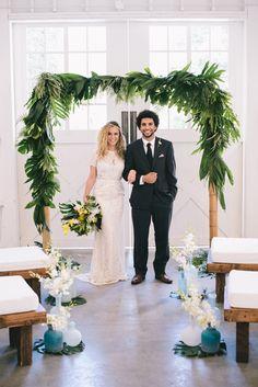 tropical ceremony altar - photo by Krista Mason Photography http://ruffledblog.com/tropical-leaves-and-sea-glass-wedding-shoot