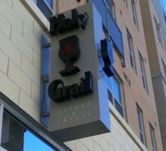 The Best Places to Eat  Holy Grail Tavern & Grille    Sports bar serving lunch and dinner with 31 hi-def TVs and 35 beers, 20 on tap. Outside patio on both sides of its corner location and three large garage doors open up. Located at The Banks.
