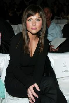 Tiffany Thiessen bangs on a wide face. This may actually make me want dark hair..