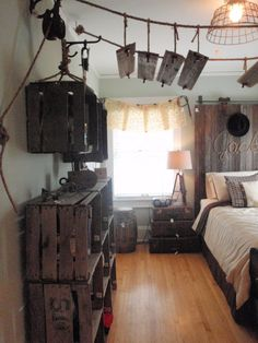 Over-the-top upcycling going on in this vintage inspired boys room. Crates, and old barn door as a headboard, old suitcases as a nightstand...