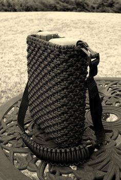 Paracord canteen cover tied mostly with basic square knotting/macrame type knot work.