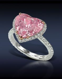 10.09Ct. Intense Pink Diamond, Mounted In 18k Rose Gold & Highlighted With a Pave' Set White Diamonds On A Platinum Shank.    Jacob & Co
