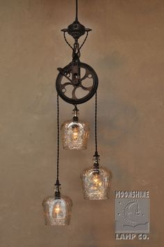 We're pleased with this brand new 3-Light version of our popular Warehouser Dual Pendant chandelier, made from recycled bottles. This fixture was commissioned by a client, using the beautifully embossed Crown Royal bottles.