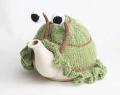 Knitted snail tea cosy with frilly bottom. Washable fits 1 litre teapot. Availble with or without teapot.