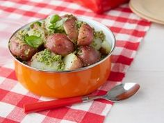 Pat's Picnic Potato Salad : Pat mixes boiled red-skinned potatoes with a quick homemade pesto sauce for a hearty picnic side that's good served cold or at room temperature.