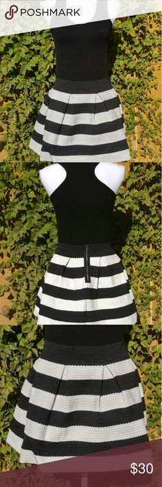 """Skirt and tank bundle BRAND: forever 21 and unknown  SIZE: Large  FLAW: top has piling  COLOR: Black and white  DESCRIPTION: Black and white thick striped skirt and black ribbed racer bank tank. Wear together and it looks like a dress! Both items are nice and stretchy. The skirt is textured as well as a bit structured. Absolutely gorgeous.  The mannequin measurements are:  Shoulders: 15"""" Chest: 34"""" Waist: 26.7"""" Hip: 35.4""""  Use #bishoujo to sort for your size. Please note I do have several…"""