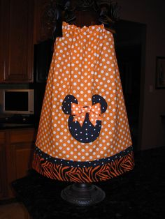 Another one for Q and the Disney trip :-)  -  Halloween Minnie Mouse Orange and White Pillowcase by STLGIRL, $20.00