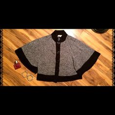 Cozy Knit Button Down Poncho Beautiful cape like sweater in excellent preloved condition. Buttons down the front so you can style it open or closed and wear it as a sweater or jacket.  100% acrylic, machine wash cold. Debbie Morgan Sweaters Shrugs & Ponchos