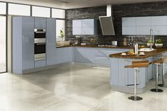 The Welford high gloss sky blue kitchen with internal and external curves - Price £2,497* #glosskitchen #bluekitchen #fittedkitchens