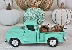 These fabric pumpkins are so adorable! I love the turquoise color and look at the little vintage truck with the acorns in it! So sweet! From Bell Jar Vintage