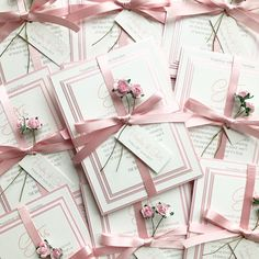 Blush / Dusky Pink Bundle Wedding Invitations.  Using Pearlescent Misty Rose borders, textured Silk for print & a pretty pink satin ribbon, finished off with mini tag and pink roses.  #blushwedding #blushinvitations #weddinginvitations #pinkinvitations #weddinginvites #floralinvitations #countrywedding