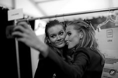 models off duty taking photos of each other backstage at herve leger during New York Fashion week