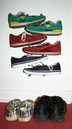 IKEA Hackers: Slick & Modern Wall-Mounted Shoe Tree - from a Pot Lid Holder (can't believe I never thought of this)