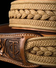 For 2013, Lozano braided a fancy rawhide lady's belt in collaboration with Pedro Pedrini. It features alternating round and flat braided elements laced together on the backside. The flat elements are Trenza Patria braiding in 12 and 16 strands while the top and bottom edge were executed in a 12-plait round braid. The centerpiece consists of three 12-plait Trenza Patria braided sections. All together there are a total of 92 strands of braiding in the belt. The belt was hand-sewn by Pedrini…