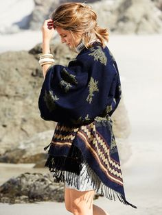 <I>Castle</I> star Stana Katic models the season's comfiest must-haves from trench capes to tartan skirts.