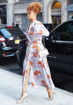 Rihanna wears a printed kimono wrap dress with metallic accessories