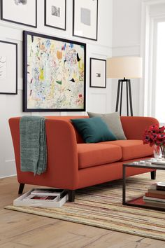 British designer Russell Pinch pares down classic parlor lines in this affordable, compact sofa scaled for casual living rooms and apartments.