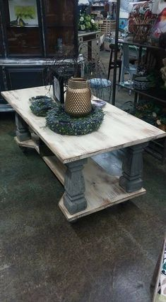 """This Coffee table is """"brute"""" it's mounted on 4 100 year old concrete spindles, with a large lower storage area, and 4 steel casters."""