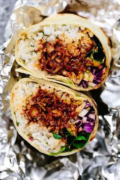 This vegan bbq jackfruit burrito is guaranteed to satisfy. Warm cilantro-lime rice, saucy bbq jackfruit, crunchy cabbage + romaine, creamy guacamole, too spicy chipotle sauce are tucked into and… Mexican Food Recipes, Whole Food Recipes, Vegetarian Recipes, Cooking Recipes, Healthy Recipes, Mexican Desserts, Cooking Tips, Freezer Recipes, Freezer Cooking