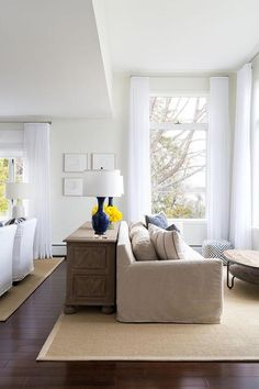 A long living room is divided into separate and distinct spaces.
