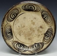 """A Japanese Edo period Seto ishizata charger in the uma-no-me (horse eye) design, The horse eye design on this large plate consists of seven concentric spirals boldly painted in iron oxide. Mingei era. 3""""H x 13 1/2""""D."""