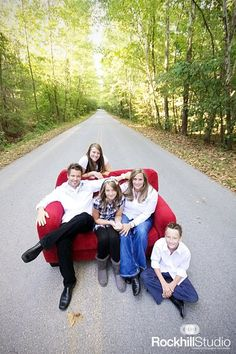 Red couch in middle of the road!! @Sarah Huddleston does this remind you of my chair idea?!?!